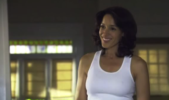 Bette smiling tank top Story