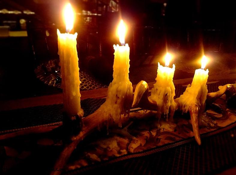 antler candles bedside Story Image